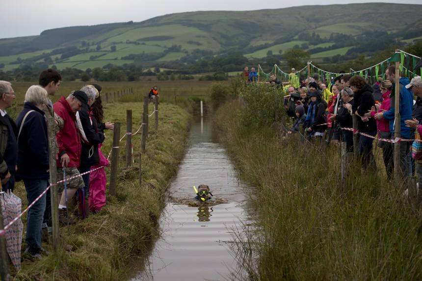 A competitor takes part in the 30th World Bog Snorkelling Championships in Waen Rhydd peat bog at Llanwrtyd Wells, south Wales on August 30, 2015. Entrants must negotiate two lengths of a 60-yard trench through the peat bog in the quickest possible time without using any conventional swimming strokes.  AFP PHOTO / OLI SCARFF        (Photo credit should read OLI SCARFF/AFP/Getty Images)