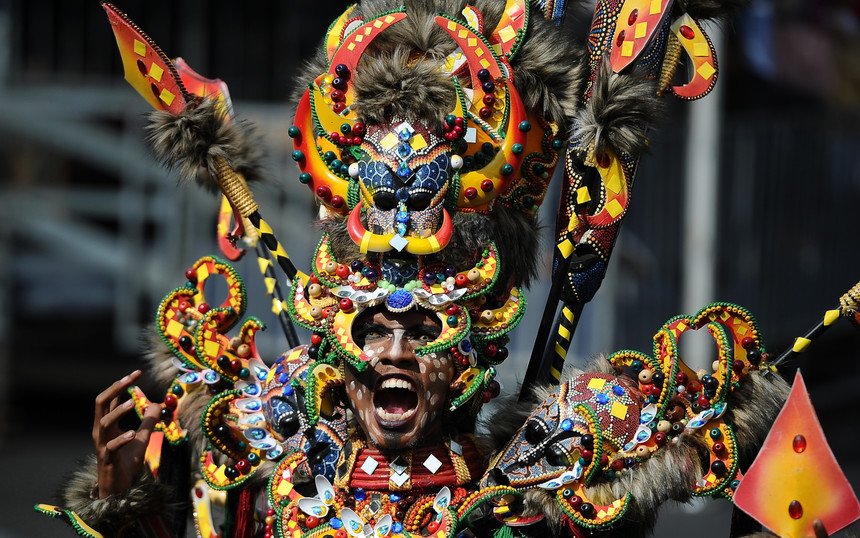 JEMBER, INDONESIA - AUGUST 30:  A model wears Melanesia outfit during Grand Carnival as part of the 14th Jember Fashion Carnival on August 30, 2015 in Jember, Indonesia. The 14th Jember Fashion Carnival 2015 theme is Outframe and consist of ten parades which include Majapahit, Ikebana, Fossil, Parrot, Circle, Pegasus, Lionfish, Egypt, Melanesia, and Reog. This street carnival is claimed to be one of the biggest in the world and comprises more than 1000 performers parading along 3.6 km of road used as the catwalk.  (Photo by Robertus Pudyanto/Getty Images)