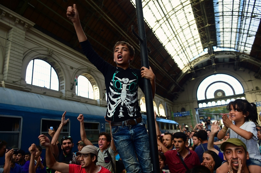 Migrants protest at the Eastern (Keleti) railway station of Budapest on September 1, 2015, during the evacuation of the railway station by local police. Budapest's main international railway station ordered an evacuation as hundreds of migrants tried to board trains to Austria and Germany, an AFP reporter at the scene said.  AFP PHOTO / ATTILA KISBENEDEK        (Photo credit should read ATTILA KISBENEDEK/AFP/Getty Images)