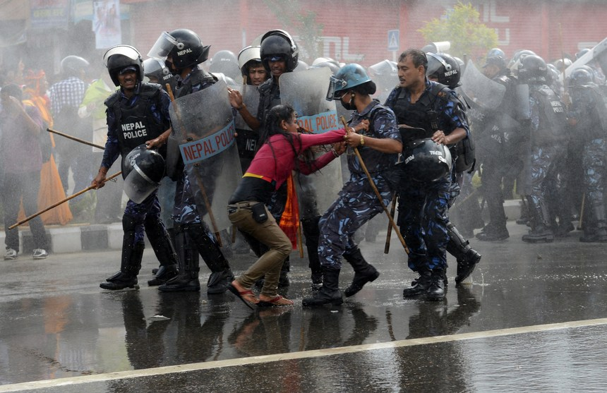 Nepalese police arrest a Hindu activist as demonstrators try to break through to a cordoned-off area near parliament during a protest demanding Nepal be declared a Hindu state in Kathmandu on September 1, 2015. Violent protests have erupted in the last few weeks in Nepal after lawmakers struck a breakthrough deal to table the draft of a new constitution, spurred by April's devastating earthquake. AFP PHOTO / Prakash MATHEMA        (Photo credit should read PRAKASH MATHEMA/AFP/Getty Images)