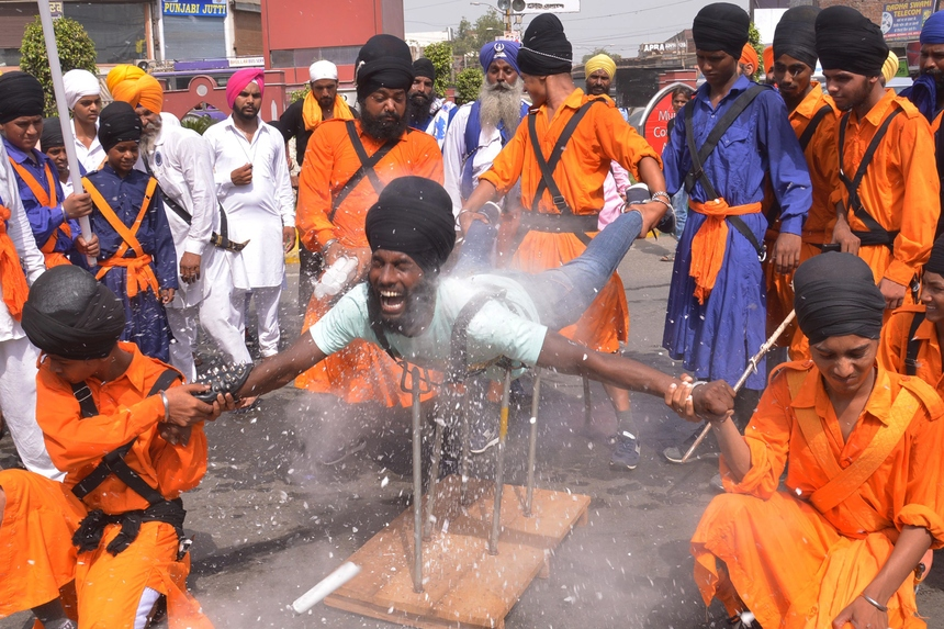 An Indian Nihang, a religious Sikh warrior, deomonstrates Sikh martial arts skills known as 'Gatka' during a march to mark the 354th birth anniversary of the Sikh warrior Shaheed Baba Jiwan Singh at the Golden temple in Amritsar on September 3, 2015. The Sikhs are celebrating Shaheed Baba Jiwan Singh, a famous warrior from the Sikh religion who lived during the 17th century. AFP PHOTO/NARINDER NANU        (Photo credit should read NARINDER NANU/AFP/Getty Images)