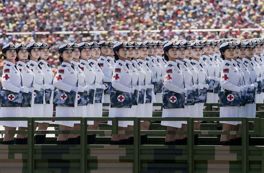 BEIJING, CHINA - SEPTEMBER 03:  Female Chinese soldiers of the medical corps ride in trucks as they pass in front of Tiananmen Square and the Forbidden City during a military parade on September 3, 2015 in Beijing, China. China is marking the 70th anniversary of the end of World War II and its role in defeating Japan with a new national holiday and a military parade in Beijing.  (Photo by Kevin Frayer/Getty Images)