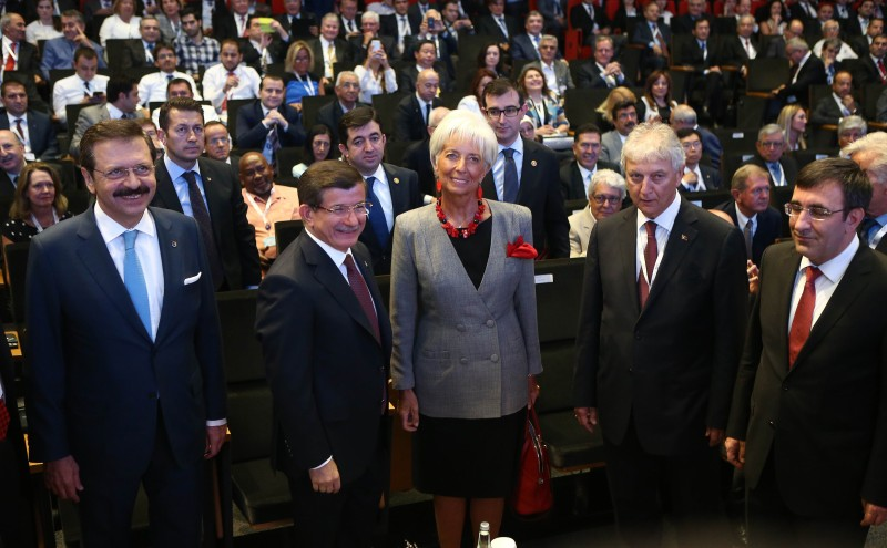 Turkish Prime Minister Ahmet Davutoglu (2ndL) and International Monetary Fund (IMF) Managing Director Christine Lagarde (C) take part in the G20 finance ministers meeting in Turkey, on September 4, 2015 in Ankara.  World finance ministers and central bankers gather in Turkey this weekend to grapple with the fallout of slowing growth in China, tanking emerging economies and panicked global stock markets. AFP PHOTO/ADEM ALTAN        (Photo credit should read ADEM ALTAN/AFP/Getty Images)