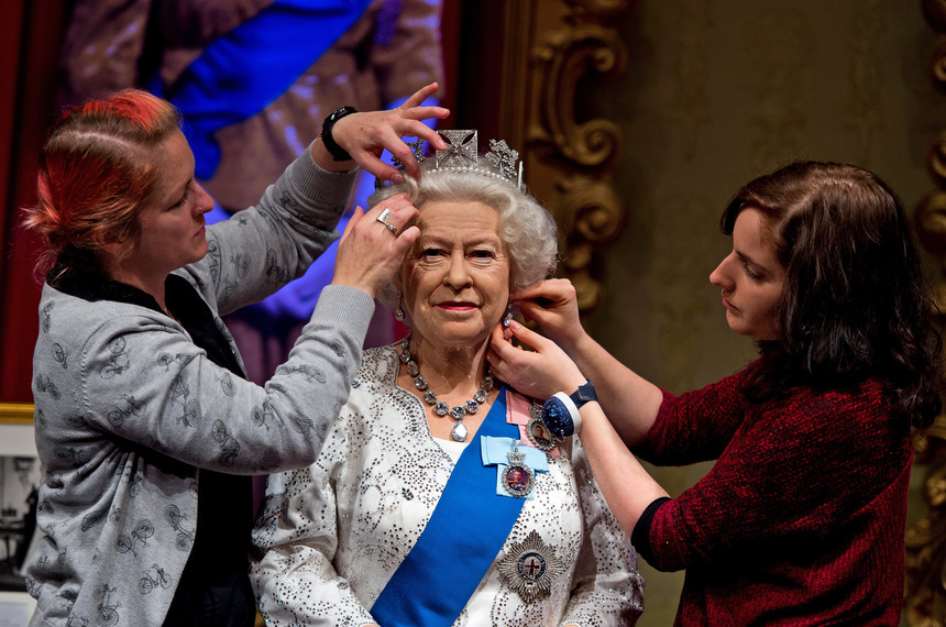 LONDON, ENGLAND - SEPTEMBER 07:  Madame Tussauds refreshes its Queen Elizabeth II wax figure with a recreation of the longest reigning monarch's diamond jubilee dress at Madame Tussauds on September 7, 2015 in London, England. The wax figure was updated after Buckingham Palace announced that on September 9, 2015 Queen Elizabeth II would surpass Queen Victoria as the longest reigning monarch.  (Photo by Ben Pruchnie/Getty Images)