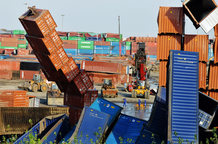 TIANJIN, CHINA - SEPTEMBER 08:  (CHINA OUT) Rescuers and machines clean up damaged shipping containers at the site of Tianjin warehouse explosion on September 8, 2015 in Tianjin, China. The death toll from the massive blasts in Tianjin rose to 161, and 12 people remained missing, officials said.  (Photo by ChinaFotoPress/Getty Images)