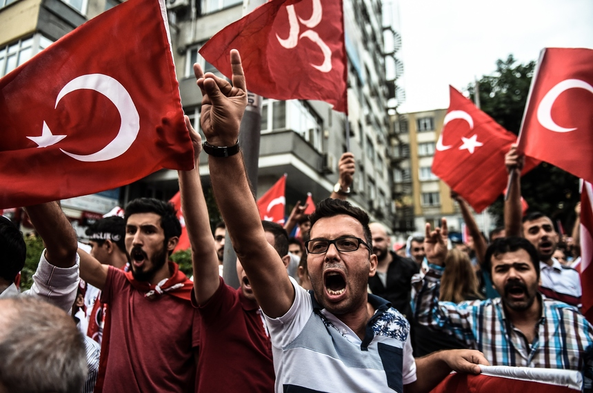 Turkish nationalists demonstrate against the Kurdish Workers Party (PKK) in Istanbul on September 8 ,2015. Turkish forces crossed into northern Iraq to pursue Kurdish militants on September 8 after the deadliest rebel attacks in years left dozens dead as the decades-long conflict escalated. Thirteen Turkish police were killed on September 8 in a new attack by PKK militants as violence in the east threatened to spiral out of control. That attack came two days after 16 Turkish soldiers were killed in a twin roadside bomb attack in Daglica in the southeastern Hakkari region, the army said, in the deadliest strike on troops in months. AFP PHOTOS / OZAN KOSE        (Photo credit should read OZAN KOSE/AFP/Getty Images)