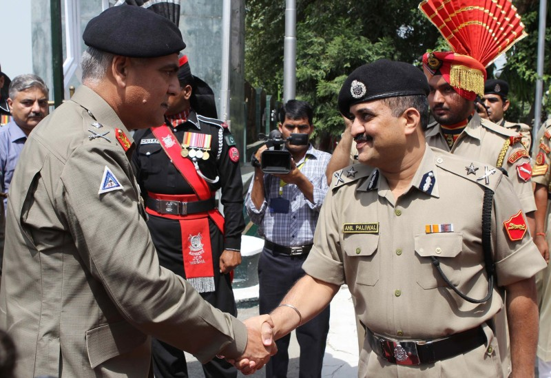 Pakistan Rangers Director General (Punjab) Major General Umar Farooq Burki (L) shakes hand with Indian Border Security Force (BSF) Inspector General ( IG) Anil Paliwal at the Wagah border crossing between India and Pakistan on September 9, 2015. Members of the Pakistan Rangers are in India for talks with the Border Security Force, scheduled to take place between September 10-13. AFP PHOTO/NARINDER NANU        (Photo credit should read NARINDER NANU/AFP/Getty Images)