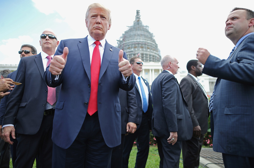 WASHINGTON, DC - SEPTEMBER 09:  Republican presidential candidate Donald Trump (2nd L) gives a thumbs up to photographers during a rally against the Iran nuclear deal on the West Lawn of the U.S. Capitol September 9, 2015 in Washington, DC. Thousands of people gathered for the rally, organized by the Tea Party Patriots, which featured conservative pundits and politicians.  (Photo by Chip Somodevilla/Getty Images)