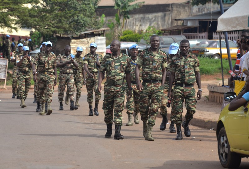 Cameroonian solider who served with the United Nations Multidimensional Integrated Stabilization Mission in the Central African Republic (MINUSCA) rally to demand the payment of their salary and other allowances by their government, on September 9, 2015, in the Cameroonian capital Yaounde.   AFP PHOTO / RENNIER KAZE        (Photo credit should read Reinnier KAZE/AFP/Getty Images)