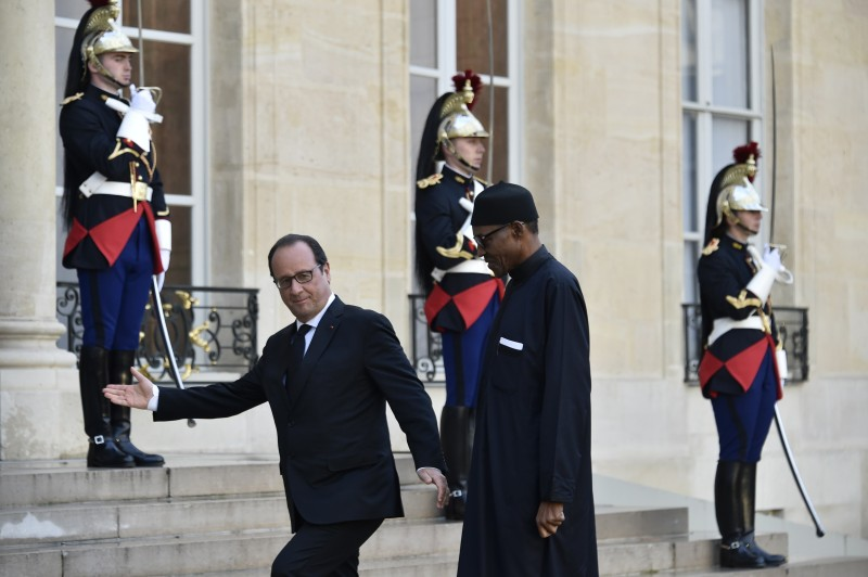 French President Francois Hollande (L) welcomes his Nigerian counterpart Muhammadu Buhari to the Elysee Presidential Palace in Paris on September 14, 2015. Nigeria's President Muhammadu Buhari will seek support for his battle against Boko Haram on a trip to Paris that starts September 14, more than three months after he took charge of Africa's largest economy. AFP PHOTO / DOMINIQUE FAGET        (Photo credit should read DOMINIQUE FAGET/AFP/Getty Images)