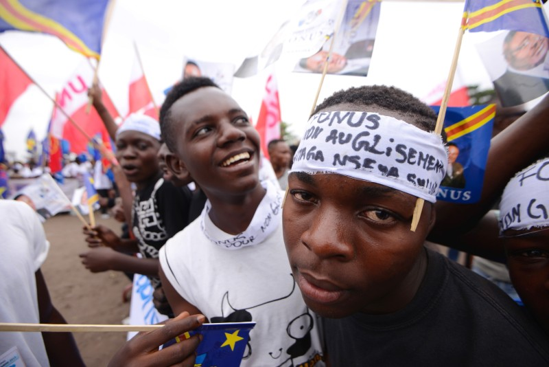 DRCongo opposition supporters gather during a rally in Kinshasa on September 15, 2015. Violent clashes broke out Tuesday in Kinshasa when an opposition rally was attacked by unidentified youths hurling stones, sparking a lynching attempt and a police crackdown, said an AFP journalist at the scene. Up to 3,000 people had gathered in a southern area of the DR Congo capital to oppose any bid by President Joseph Kabila to seek a third term in elections due at the end of next year. AFP PHOTO / JUNIOR KANNAH        (Photo credit should read JUNIOR KANNAH/AFP/Getty Images)