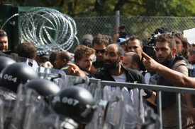 A migrant girl cries after being hit by pepper spray and tear gas after hungarian police repelled an attempt by migrants break the border post gate and pull down the razor wire fence on September 16, 2015 in Horgos, Serbia. Hungary has introduced tough new laws to administer the influx of migrants  and has also declared a state of emergency in two of it's counties close to the border. The new laws have created a dead end for migrants arriving at the Horgos frontier post resulting in clashes with migrants and hungarian police.