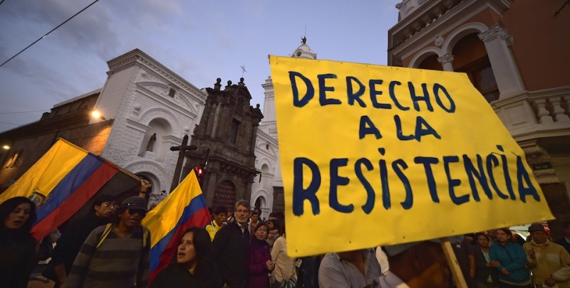 "Opponents demonstrate against the government of Ecuadorean President Rafael Correa with a sign reading ""Right of resistance"" in Quito on September 16, 2015. AFP PHOTO / RODRIGO BUENDIA        (Photo credit should read RODRIGO BUENDIA/AFP/Getty Images)"