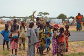 A picture taken on September 16, 2015 shows children standing in the Assaga refugee camp,  set up by the UN three months ago for Nigerian refugees who fled to southeast Niger to escape the Islamist group Boko Haram. In the Assaga camp, many refugees live in abject poverty and sleep in makeshift shelters at the mercy of mosquitoes and bad weather, an AFP reporter saw. AFP PHOTO / BOUREIMA HAMA        (Photo credit should read BOUREIMA HAMA/AFP/Getty Images)