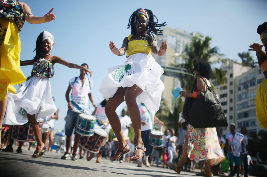 RIO DE JANEIRO, BRAZIL - SEPTEMBER 20:  Afro-Brazilian worshippers dance at a march for religious freedom on September 20, 2015 in Rio de Janeiro, Brazil. The march included practitioners of Candomble, Umbanda, Buddhism and Christianity. Practiioners of Afro-Brazilian religions remain persecuted to this day in spite of attempts at post-slavery reforms to integrate Africa-based religions.  (Photo by Mario Tama/Getty Images)