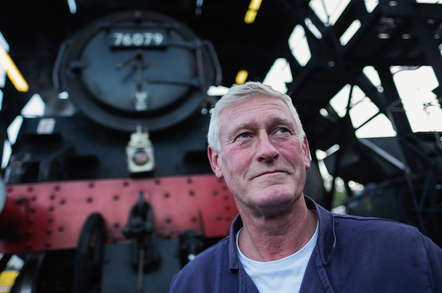 GROSMONT, ENGLAND - SEPTEMBER 24:  Driver Stuart Whitter stands in front of  his engine, the Standard Class 4MT 2-6-0 steam locomotive 76079 as maintenance is carried out in the Grosmont railway sheds at the North Yorkshire Moors Railway on September 24, 2015 in Grosmont, England. Final preparations are being made ahead of the railway's Autumn Steam Gala which begins on Friday 25th September  and runs through the weekend. The gala will offer a range of attractions for steam enthusiasts and visitors to the historic Yorkshire railway.  (Photo by Ian Forsyth/Getty Images)