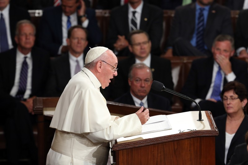 WASHINGTON, DC - SEPTEMBER 24:  Pope Francis addresses a joint meeting of the U.S. Congress in the House Chamber of the U.S. Capitol on September 24, 2015 in Washington, DC.  Pope Francis is the first pope to address a joint meeting of Congress and will finish his tour of Washington later today before traveling to New York City.  (Photo by Win McNamee/Getty Images)