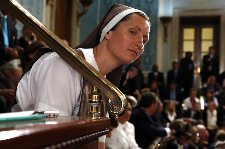 WASHINGTON, DC - SEPTEMBER 24:  A nun listens as Pope Francis addresses a joint meeting of the U.S. Congress in the House Chamber of the U.S. Capitol on September 24, 2015 in Washington, DC.  Pope Francis is the first pope to address a joint meeting of Congress and will finish his tour of Washington later today before traveling to New York City.  (Photo by Chip Somodevilla/Getty Images)