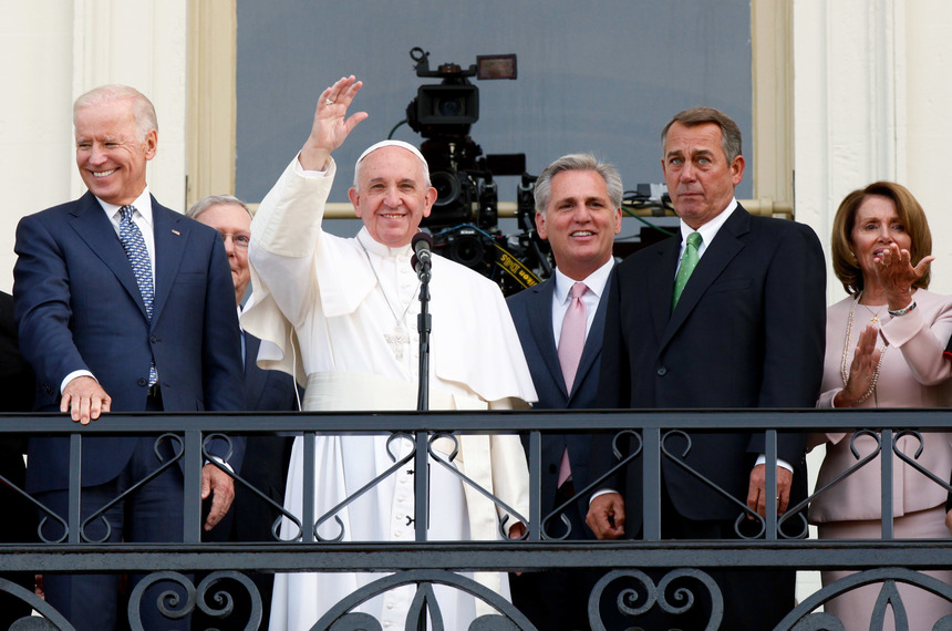 WASHINGTON, DC - SEPTEMBER 24:  Pope Francis (2nd L) waves to crowd from the balcony of the US Capitol building, after his address to a joint meeting of the U.S. Congress as (L to R) U.S. Vice President Joe Biden, House Majority Leader Kevin McCarthy (R-CA), Speaker of the House John Boehner (R-OH) and House Democratic Leader Rep. Nancy Pelosi (D-CA) look on September 24, 2015 in Washington, D.C. Pope Francis, the first pope to address a joint meeting of Congress, will finish his tour of Washington later today before traveling to New York City.  (Photo by Evy Mages/Getty Images)