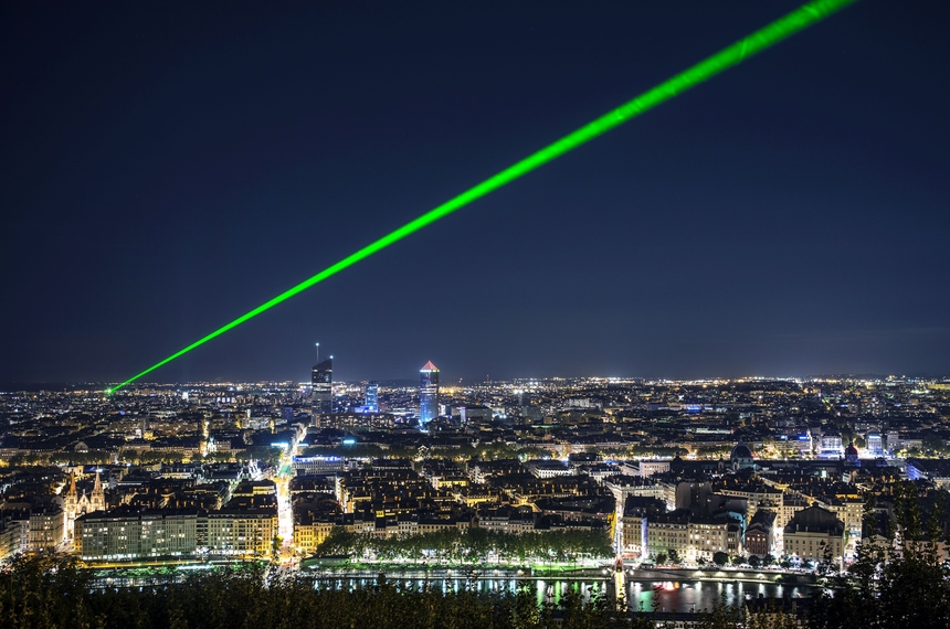 A green laser ray is emitted above Lyon to calculate the variations of light speed in the atmosphere on September 24, 2015. AFP PHOTO / JEFF PACHOUD        (Photo credit should read JEFF PACHOUD/AFP/Getty Images)