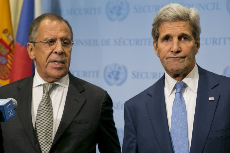 "United States Secretary of State John Kerry (R) and Russia Foreign Minister Sergey Lavrov speak to the media after a meeting concerning Syria at the United Nations headquarters in New York on September 30, 2015. Russia's air strikes in Syria targeted opposition forces and not Islamic State jihadists, a US defense official said, contradicting Russian claims. At the United Nations in New York, Secretary of State John Kerry made clear that Washington would have ""grave concerns"" should Moscow opt to strike targets in areas where IS fighters and Al-Qaeda-linked groups are not operating. AFP PHOTO/Dominick Reuter        (Photo credit should read DOMINICK REUTER/AFP/Getty Images)"