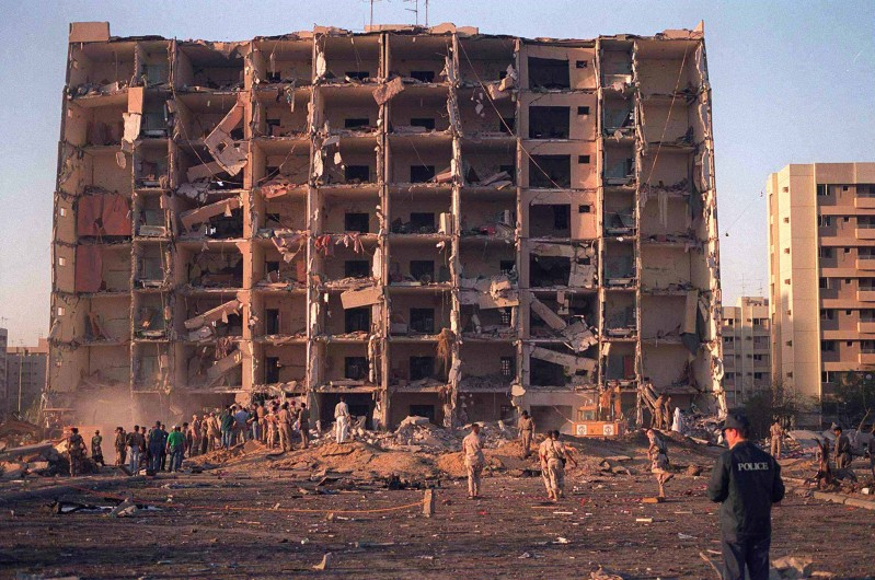 390912 01: U.S. And Saudi Military Personnel Survey The Damage To Khobar Towers Caused By The Explosion Of A Fuel Truck June 25, 1996 Outside A Fence Around The Facility On King Abdul Aziz Air Base Near Dhahran, Saudi Arabia . Several Buildings Were Damaged And There Were Numerous U.S. Casualties. U.S. Attorney General John Ashcroft And Fbi Director John Freeh Announced The Indictment Of 13 Saudi Nationals And One Lebanese National In Connection With The 1996 Bombing That Killed 19 American Servicemen June 21, 2001 In Washington, D.C.  (Photo By Getty Images)
