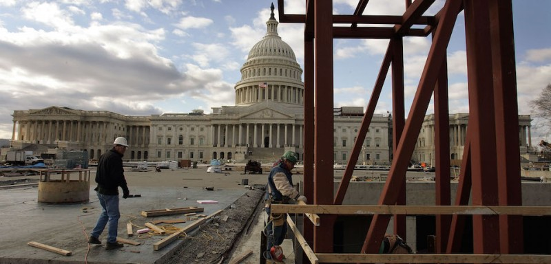 WASHINGTON - DECEMBER 14:  Workers work on an elevator shaft in front of the U.S. Capitol during construction of The Capitol Visitor Center December 14, 2004 in Washington, DC. The new center will include space for security, exhibits, food services, two orientation theaters, an auditorium, gift shops, a service tunnel for truck loading and deliveries, mechanical facilities and storage.   (Photo by Joe Raedle/Getty Images)