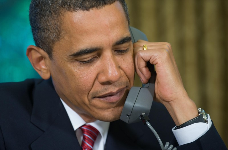 US President Barack Obama talks on the phone with Astronauts aboard the Space Shuttle Atlantis, while on a mission to repair the Hubble Space Telescope, from the Oval Office of the White House in Washington, DC, May 20, 2009. AFP PHOTO / Saul LOEB (Photo credit should read SAUL LOEB/AFP/Getty Images)