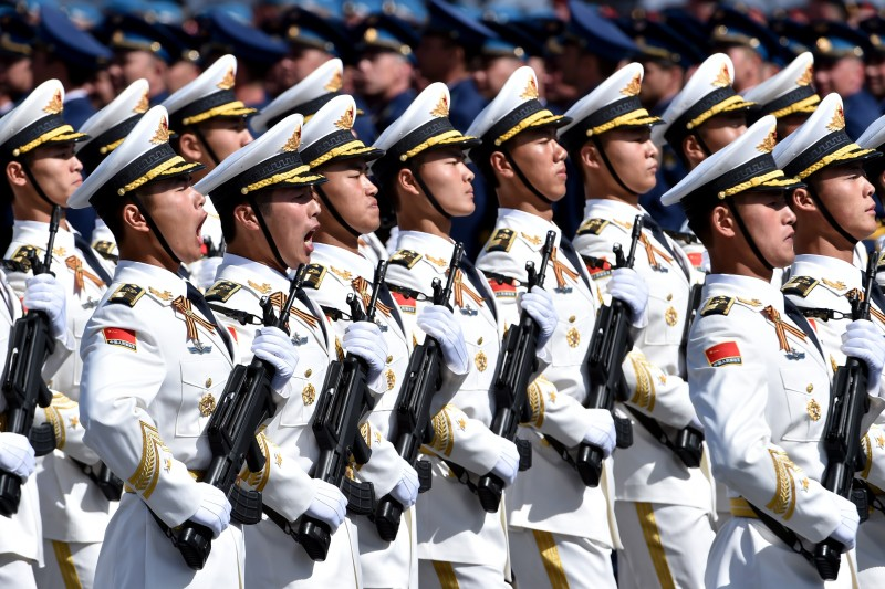 China's soldiers march through Red Square during the Victory Day military parade in Moscow on May 9, 2015. Russian President Vladimir Putin presided over a huge Victory Day parade celebrating the 70th anniversary of the Soviet win over Nazi Germany, amid a Western boycott of the festivities over the Ukraine crisis. AFP PHOTO / KIRILL KUDRYAVTSEV        (Photo credit should read KIRILL KUDRYAVTSEV/AFP/Getty Images)