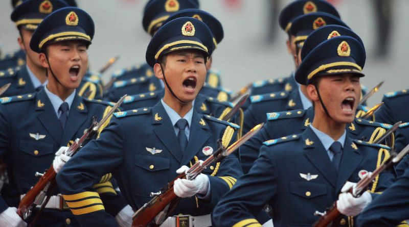 This photo shows members of the Chinese Navy, a division of the People's Liberatiuon Army (PLA), shouting while marching during a welcoming ceremony at the Great Hall of the People in Beijing, China on October 24, 2007.