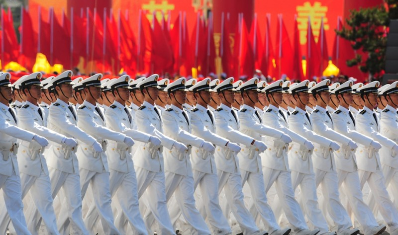 Chinese People's Liberation Army (PLA) naval officers march pass Tiananmen Square during the National Day parade in Beijing on October 1, 2009.  China formally kicked off mass celebrations of 60 years of communist rule with a 60-gun salute that rung out across Beijing's historic Tiananmen Square.        AFP PHOTO/FREDERIC J. BROWN (Photo credit should read FREDERIC J. BROWN/AFP/Getty Images)