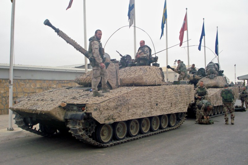 Swedish soldiers with the NATO-led International Security Assistance Force (ISAF) are seen with their tanks in the outskirts of Mazar-i-Sharif on November 3, 2010. Sweden aims to pull its combat troops out of Afghanistan between 2012 and 2014 and will maintain a largely civilian support presence after that, Prime Minister Fredrik Reinfeldt said November 1. AFP PHOTO/Kazim Ebrahimkhil (Photo credit should read KAZIM EBRAHIMKHIL/AFP/Getty Images)