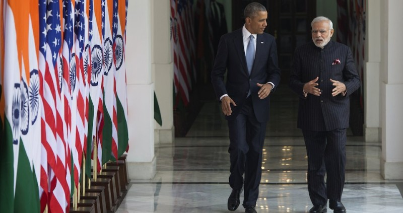 Indian Prime Minister Narendra Modi (R) and US President Barack Obama walk prior to meetings at Hyderabad House in New Delhi, India, January 25, 2015. US President Barack Obama began a landmark visit to India on January 25 with a bear hug from Prime Minister Narendra Modi, signalling a new warmth in a sometimes strained relationship. AFP PHOTO / SAUL LOEB        (Photo credit should read SAUL LOEB/AFP/Getty Images)