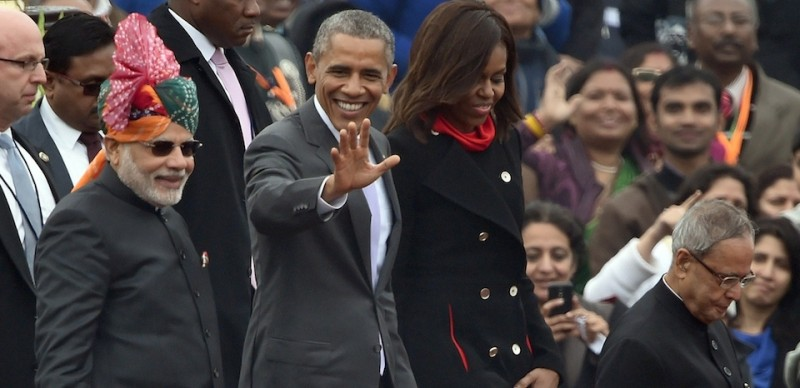US President Barack Obama (2L) waves to spectators as he leaves with US First Lady Michelle Obama (2R), Indian Prime Minister Narendra Modi (L) and Indian President Pranab Mukherjee (R) after attending India's Republic Day parade on Rajpath in New Delhi on January 26, 2015. Rain failed to dampen spirits at India's Republic Day parade January 26 as Barack Obama became the first US president to attend the spectacular military and cultural display in a mark of the nations' growing closeness. AFP PHOTO/ PRAKASH SINGH        (Photo credit should read PRAKASH SINGH/AFP/Getty Images)