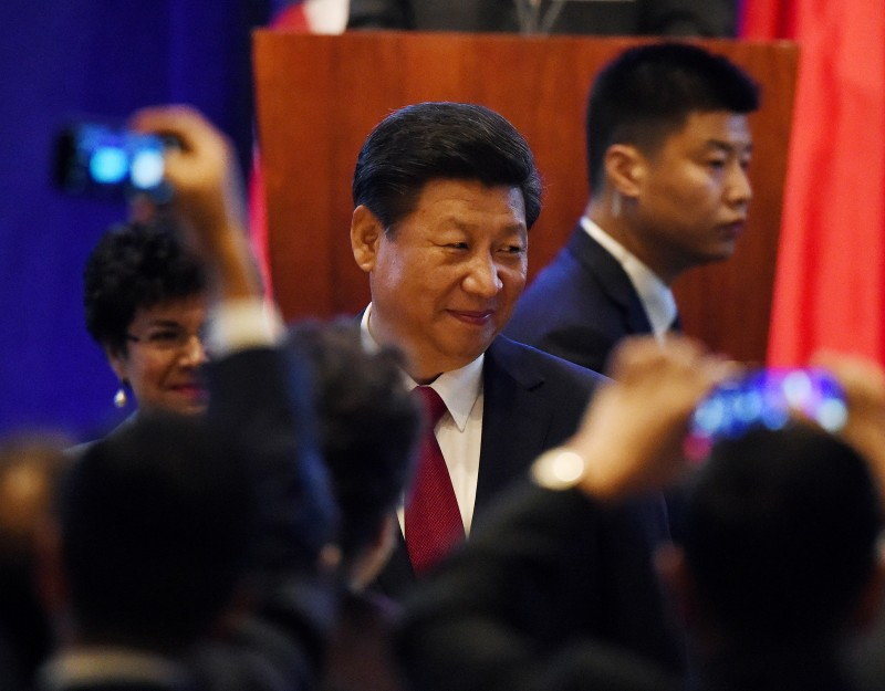 Chinese President Xi Jinping arrives for his welcoming banquet on the start of his visit to the United States, at the Westin Hotel in Seattle, Washington on September 22, 2015.  President Xi will makes a high-profile state visit to the White House this week, but he stops first in Washington state on the west coast to shore up support among skittish allies, especially big business. The Seattle talks will be heavily focused on business, trade and economics.          AFP PHOTO/MARK RALSTON        (Photo credit should read MARK RALSTON/AFP/Getty Images)