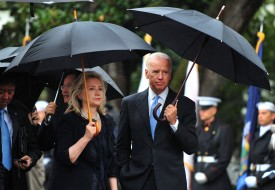 WASHINGTON - OCTOBER 13:  (AFP OUT)  U.S. Vice President Joe Biden talks to U.S. Secretary of State Hillary Clinton during an arrival ceremony for South Korean President Lee Myung-bak on the South Lawn of the White House October 13, 2011 in Washington, D.C. Later in the day Lee is scheduled to hold a joint press conference with Obama and also address a joint meeting of Congress.  (Photo by Kevin Dietsch-Pool/Getty Images)