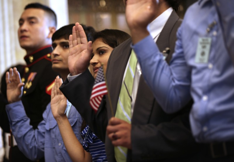 WASHINGTON, DC - JULY 03:  (L-R) U.S. Marine Corps Lance Cpl. Nicolas Alvarado Lopez, who was originally from Ecuador, of Queens, New York, and siblings Mayank Patel and Hitarthi Patel, who were originally from India, of Fairfax, Virginia, are sworn in during a naturalization ceremony at the Treasury Department July 3, 2013 in Washington, DC. More than 7,800 people will become citizens at more than 100 special ceremonies, as part of the United States Citizenship and Immigration Services' (USCIS) annual celebration of Independence Day, across the country and around the world from July 1 to July 5.  (Photo by Alex Wong/Getty Images)