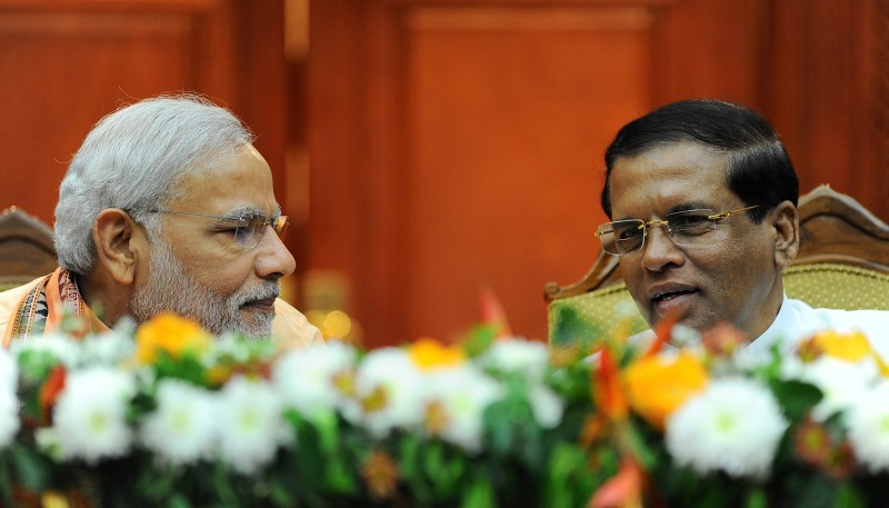 Indian Prime Minister Narendra Modi (L) and Sri Lankan President Maithripala Sirisena interact during a meeting at the Presidential Secretariat in Colombo on March 13, 2015.   India's Prime Minister Narendra Modi urged Sri Lanka's new leaders to grant  greater autonomy to minority Tamils who suffered the most during decades of ethnic war.    AFP PHOTO / ISHARA S.KODIKARA        (Photo credit should read Ishara S.KODIKARA/AFP/Getty Images)