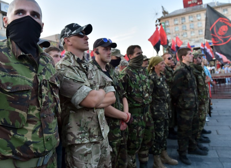 Activists and supporters of far-right Ukrainian party Right Sector participate in a rally on Independence Square in Kiev on July 21, 2015 after the party's extraordinary congress. Several thousand protesters gathered to support the party's decision to start collecting signatures for a referendum calling for for the resignation of President Petro Poroshenko and his government.  AFP PHOTO/ SERGEI SUPINSKY        (Photo credit should read SERGEI SUPINSKY/AFP/Getty Images)