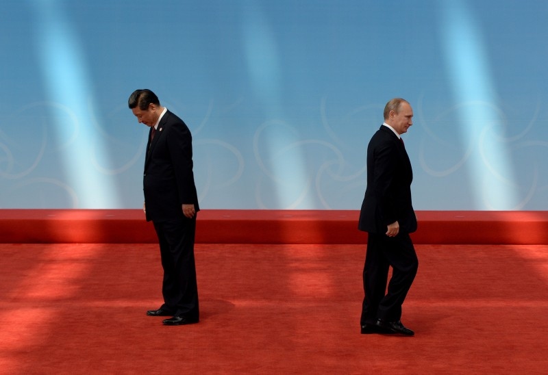 Russian President Vladimir Putin (R) leaves after being greeted by Chinese President Xi Jinping before the opening ceremony at the Expo Center at the fourth Conference on Interaction and Confidence Building Measures in Asia (CICA) summit in Shanghai on May 21, 2014.     AFP PHOTO/POOL/ Mark RALSTON        (Photo credit should read MARK RALSTON/AFP/Getty Images)