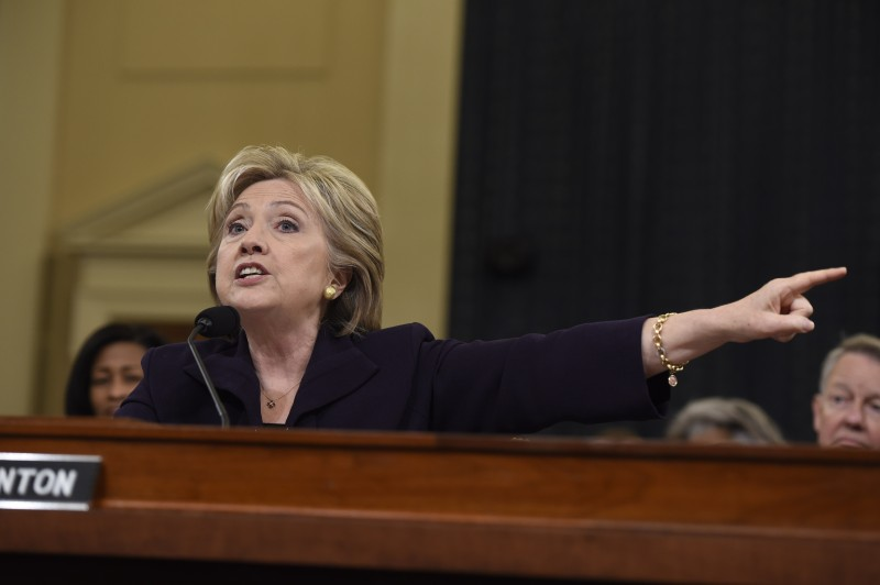 Former Secretary of State and Democratic Presidential hopeful Hillary Clinton testifies before the House Select Committee on Benghazi on Capitol Hill in Washington, DC, October 22, 2015. Clinton took the stand Thursday to defend her role in responding to deadly attacks on the US mission in Libya, as Republicans forged ahead with an inquiry criticized as partisan anti-Clinton propaganda.   AFP PHOTO / SAUL LOEB        (Photo credit should read SAUL LOEB/AFP/Getty Images)