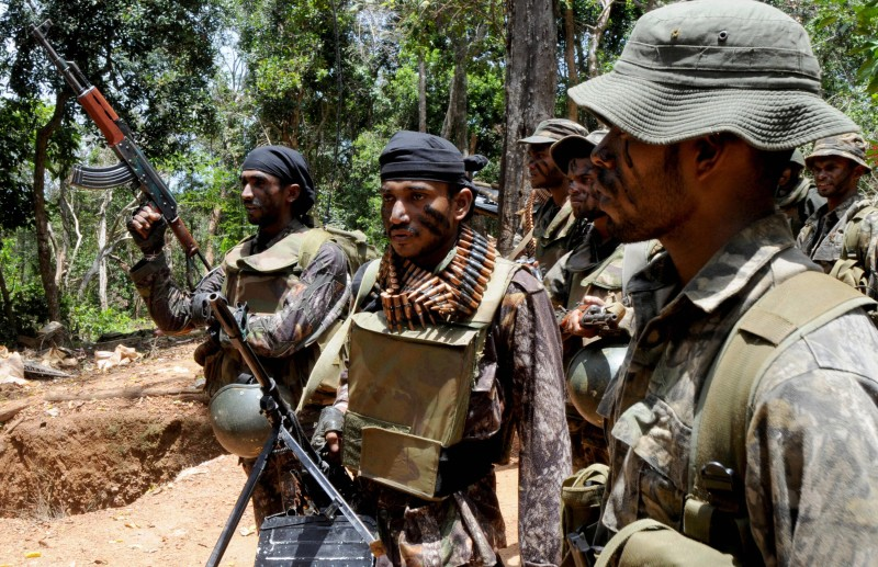 Sri Lanka army soldiers take up position in the north-eastern region of Weli Oya on March 27, 2008. Sri Lanka has launched a probe into a mystery poster campaign that is asking would-be Tamil Tiger suicide bombers to turn themselves in to government hands in return for cash. Tens of thousands have died since the LTTE launched an armed struggle in 1972, to carve out a separate homeland for minority Tamils from the majority Sinhalese community in the island's north and east. The Tigers are fighting for an independent homeland for minority Tamils from the majority Sinhalese community in the island's north and east.     AFP PHOTO/STR (Photo credit should read STR/AFP/Getty Images)