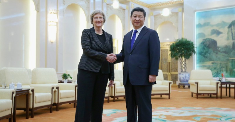 BEIJING, CHINA - MARCH 16:  Chinese President Xi Jinping (Right) shakes hands with Harvard University President Drew Gilpin Faust (Left) at the Great Hall of the People on March 16, 2015 in Beijing, China.  (Photo by Feng Li - Pool/Getty Images)