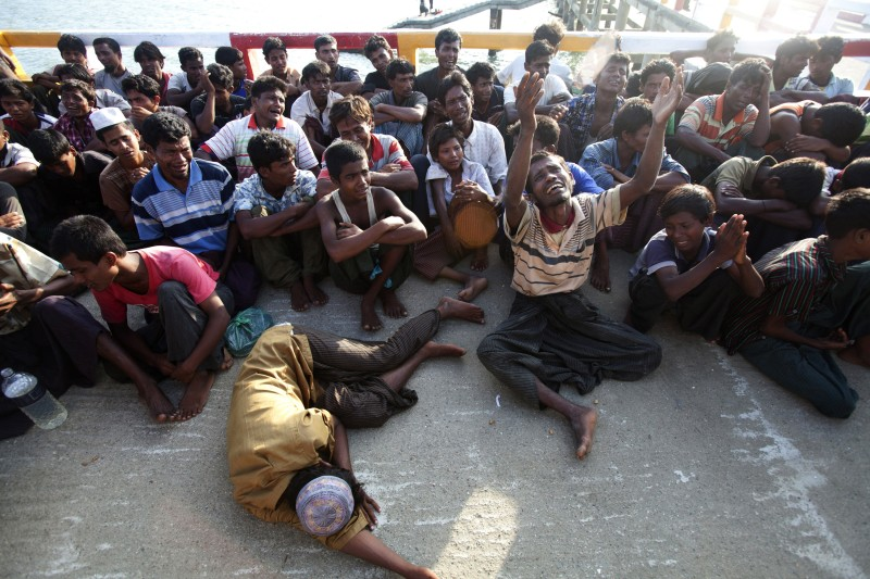 Rohingya Muslims from Myanmar, who tried to cross the Naf river into Bangladesh to escape sectarian violence, cry as they receive news that they cannot find refuge in the country, in Teknaf, on June 18, 2012. At least 50 people have died in western Myanmar's Rakhine state in more than a week of sectarian violence and revenge attacks between Buddhists and Muslim Rohingya. Bangladesh is coming under increasing international pressure to open its border to Rohingya, but has so far refused to do so. AFP PHOTO/ STRINGER        (Photo credit should read STRINGER/AFP/GettyImages)