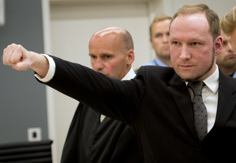 """Self confessed mass murderer Anders Behring Breivik raises his fist in a right wing salute after being sentenced to 21 years in prison, in court room 250 at Oslo District Court on August 24, 2012. An Oslo court today found Anders Behring Breivik guilty of """"acts of terror"""" and sentenced him to 21 years in prison for his killing spree last year that left 77 people dead. Breivik today dismissed his sentence of 21 years in jail by declaring the Oslo court """"illegitimate"""", but also said he would not appeal the sentence. AFP PHOTO / ODD ANDERSEN        (Photo credit should read ODD ANDERSEN/AFP/GettyImages)"""