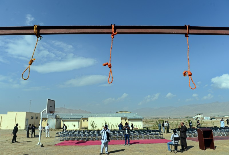 """Nooses hang at Pul-e-Charkhi prison, on the outskirts of Kabul on October 8, 2014.  Five Afghan men were hanged on October 8 for the gang rape of four women despite the United Nations and human rights groups criticising the trial and calling for new President Ashraf Ghani to stay the executions.  """"Five men in connection to the Paghman incident and one other big criminal were executed this afternoon,"""" Rahmatullah Nazari, the deputy attorney general, told AFP.   AFP PHOTO/Wakil Kohsar        (Photo credit should read WAKIL KOHSAR/AFP/Getty Images)"""