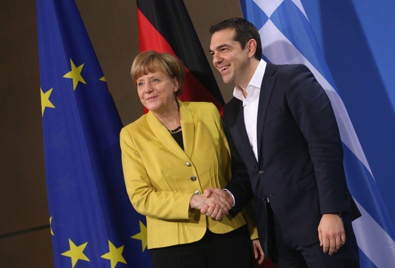 BERLIN, GERMANY - MARCH 23:  German Chancellor Angela Merkel and Greek Prime Minister Alexis Tsipras depart after speaking to the media following talks at the Chancellery on March 23, 2015 in Berlin, Germany. The two leaders are meeting as relations between the Tsipras government and Germany have soured amidst contrary views between the two countries on how Greece can best work itself out of its current economic morass.  (Photo by Sean Gallup/Getty Images)