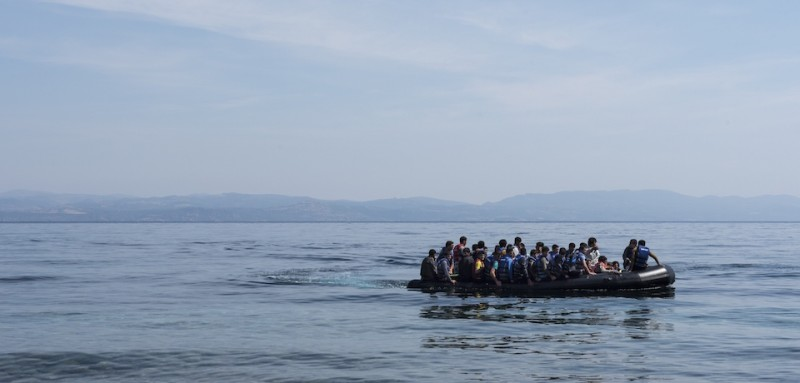 Refugees from Afghanistan arrive in a boat on the shores of Lesbos near Skala Skamnias, Greece on June 2, 2015. Lesbos, the Greek vacation island in the Aegean Sea between Turkey and Greece, faces massive refugee flows from the Middle East countries. Women and children are seen at the beaches and the cities of Lesbos, exhausted after the trip over the Aegean Sea. Some children are even born on the flight from war. Last week alone over 2500 refugees arrived on the island, where they will be registred by Greek authorities. After registration most refugees are left on their own.  AFP PHOTO / SCANPIX DENMARK / SOEREN BIDSTRUP +++ DENMARK OUT        (Photo credit should read SOEREN BIDSTRUP/AFP/Getty Images)