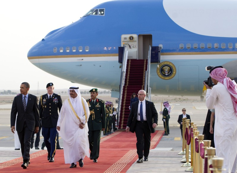 US President Barack Obama (L) is welcomed by Prince Khaled Bin Bandar Bin Abdul Aziz, Emir of Riyadh (3rdL), upon his arrival at King Khalid International Airport in Riyadh, Saudi Arabia, on March 28, 2014. Obama arrived in Riyadh for talks with Saudi King Abdullah as mistrust fuelled by differences over Iran and Syria overshadows a decades-long alliance between their countries. AFP PHOTO / SAUL LOEB        (Photo credit should read SAUL LOEB/AFP/Getty Images)