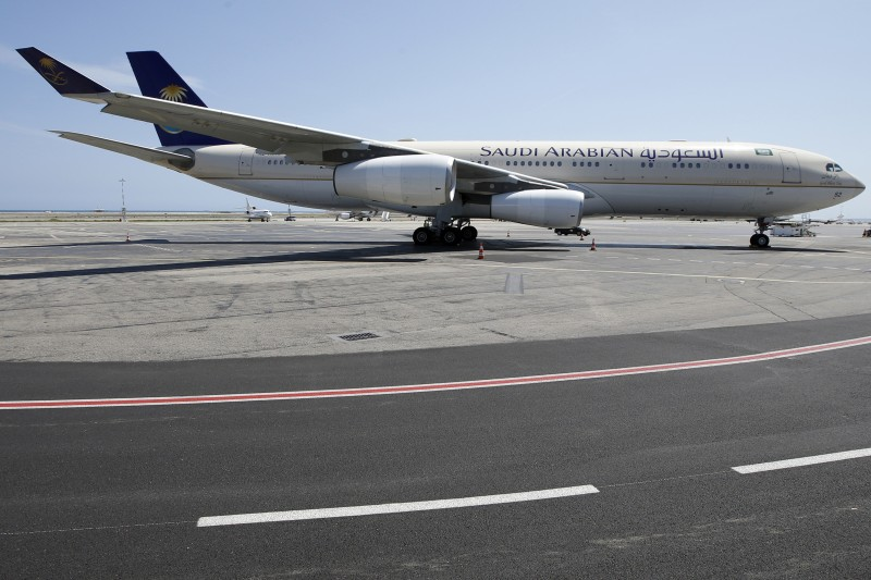 A Saudi Airlines plane sits on the tarmac at Nice airport in southeastern France on July 26, 2015. King Salman of Saudi Arabia arrived in France for a Riviera holiday, with the closure of the beach in front of his villa incensing local residents. While the king's three-week visit with an entourage of nearly 1,000 is a boon for the local economy, the closure of a public beach for the privacy and security of the royal party -- along with illegal construction work -- has sparked anger. AFP PHOTO / VALERY HACHE        (Photo credit should read VALERY HACHE/AFP/Getty Images)